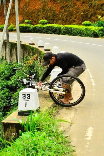 Off the edge: Strong gust almost sent Dhanushka's bicycle off the edge