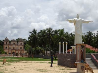 Old church and a statue to commemorate the Tsunami victims
