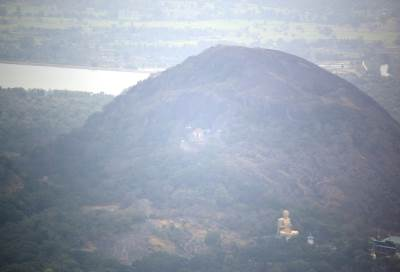 Dambulla rock, cave temple and golden plated Buddha statue