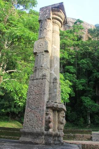 A stone pillar decorated by carvings