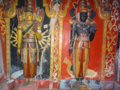 These are statues of God Kataragama (left) and another. Note the crosses around their necks