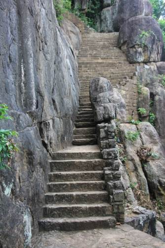 The stairway. Only one or two persons can proceed at once through the narrow point. This is to reduce the speed of enemy troops proceeding, in case of an attack