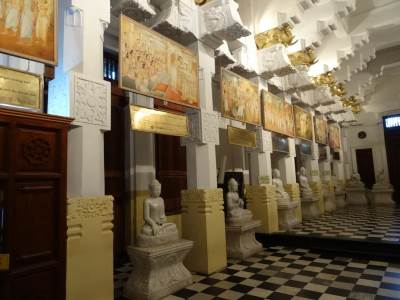 Buddha statues line all along the hall