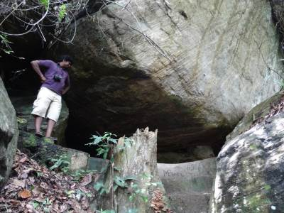 Ashan the Caveman inspecting a prospective shelter